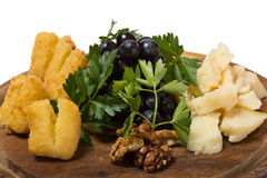 Assorted cheese with grapes and walnuts. Stock Photography