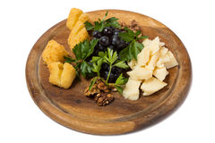 Assorted cheese with grapes and walnuts. Royalty Free Stock Image