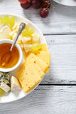 Assorted cheese on a plate Royalty Free Stock Photo