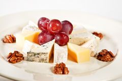 Assorted cheese plate Royalty Free Stock Image