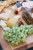 Assorted cheese plate table whit fruits Royalty Free Stock Image