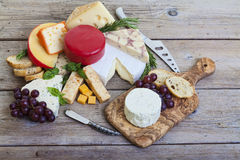 Assorted cheese platter. Assorted cheese on wood platter Royalty Free Stock Photo
