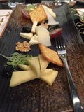 Assorted Cheese Platter on Wooden Tray royalty free stock photos