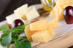 Assorted cheese on a wooden board Stock Image