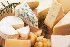 Assorted cheese on wooden platter. Rich and healthy breakfast or snack food Stock Photography