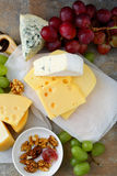 Assorted of cheeses with grapes and walnuts Royalty Free Stock Image