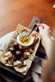 Assorted cheeses with honey and nuts Stock Photography
