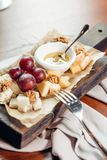 Assorted cheeses with honey and nuts Royalty Free Stock Images