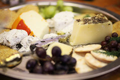 Assorted cheeses and snacks Royalty Free Stock Images