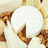 Assorted cheeses on wooden plate Stock Photo