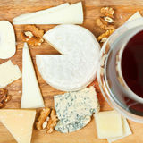 Assorted cheeses on wooden plate Royalty Free Stock Photos