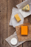 Assorted cheeses on the wooden table Royalty Free Stock Image