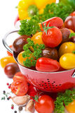Assorted cherry tomatoes in a colander Stock Images