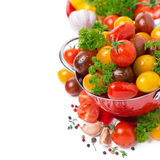 Assorted cherry tomatoes in a colander, spices and fresh herbs Royalty Free Stock Photo