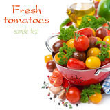 Assorted cherry tomatoes in a colander, spices, olive oil Stock Photo