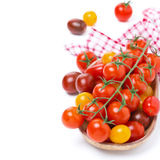 Assorted cherry tomatoes in wooden bowl, isolated Stock Photos
