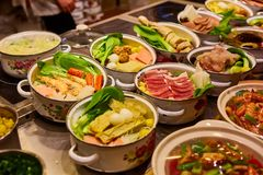 Assorted Chinese food set. Chinese noodles, fried rice, dumplings, peking duck, dim sum, spring rolls. Famous Chinese royalty free stock image