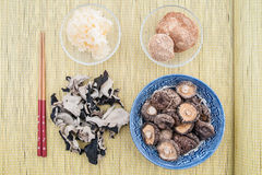 Assorted chinese mushrooms on bamboo background Stock Photos
