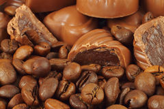 Assorted chocolate candies and coffee beans Royalty Free Stock Photo