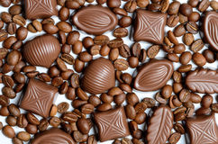 Assorted chocolate candy on the background of coffee beans isola Royalty Free Stock Image