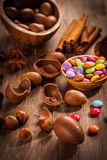 Assorted chocolate eggs for Easter. On wooden background Royalty Free Stock Photography