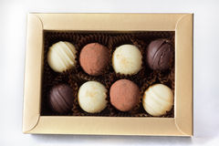 Assorted chocolates. A golden box with eight assorted chocolates Royalty Free Stock Photography
