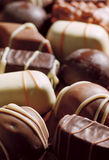 Assorted chocolates. Close-up. Selective focus on foreground. Film scan Stock Photography