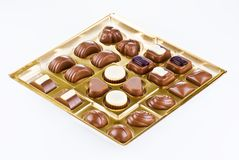 Assorted chocolates in the box Stock Images
