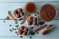 Assorted chocolates. candy balls of different types of chocolate on a blue wooden table. cocoa, cinnamon, star anise and coffee be. Ans. top view royalty free stock photos