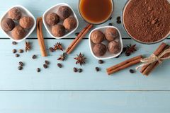 Assorted chocolates. candy balls of different types of chocolate on a blue wooden table. cocoa, cinnamon, star anise and coffee be. Ans. view from above. free royalty free stock image