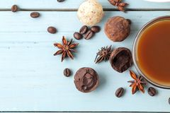 Assorted chocolates. candy balls of different types of chocolate on a blue wooden table. cocoa, cinnamon, star anise and coffee be. Ans. top view stock images