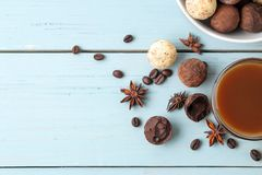 Assorted chocolates. candy balls of different types of chocolate on a blue wooden table. cocoa, cinnamon, star anise and coffee be. Ans. view from above. free royalty free stock photos