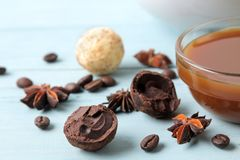 Assorted chocolates. candy balls of different types of chocolate on a blue wooden table. cocoa, cinnamon, star anise and coffee be. Ans stock images
