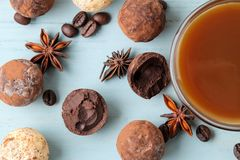 Assorted chocolates. candy balls of different types of chocolate on a blue wooden table. cocoa, cinnamon, star anise and coffee be. Ans. top view royalty free stock images