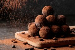 Assorted chocolates. candy balls of different types of chocolate on a dark background. cocoa and coffee beans stock photo