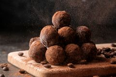 Assorted chocolates. candy balls of different types of chocolate on a dark background. cocoa and coffee beans. Assorted chocolates. candy balls of different royalty free stock photos