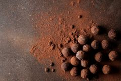 Assorted chocolates. candy balls of different types of chocolate on a dark background. cocoa and coffee beans. top view royalty free stock images