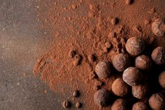 Assorted chocolates. candy balls of different types of chocolate on a dark background. cocoa and coffee beans. top view stock photography