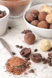 Assorted chocolates. Candy balls of different types of chocolate on a light concrete background. cocoa, star anise and coffee bean. S royalty free stock photography