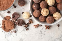 Assorted chocolates. Candy balls of different types of chocolate on a light concrete background. cocoa, star anise and coffee bean. S. top view stock photo