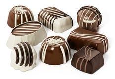 Assorted chocolates isolated on white background. 3D illustration Stock Photography