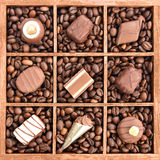 Assorted chocolates in wooden box Royalty Free Stock Image