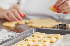 Assorted Christmas biscuits. Homemade cookies and cookie cutter. Stock Photo