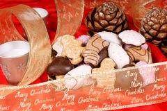 Assorted Christmas gingerbread cookies. And Christmas decorations over a red background Stock Photo
