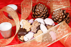 Assorted Christmas gingerbread cookies. And Christmas decorations over a red background Stock Photos