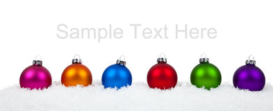 Assorted Christmas ornaments/baubles on white Royalty Free Stock Photo