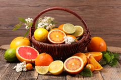 Assorted citrus fruit. On wood stock image