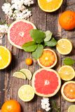 Assorted citrus fruit. On wood Royalty Free Stock Photo