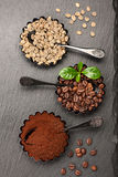 Assorted coffee. Green raw coffee, ground coffee, coffee beans. Top view Royalty Free Stock Photo