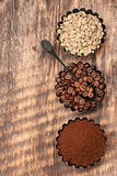 Assorted coffee. Green raw coffee, ground coffee, coffee beans. Top view Stock Images
